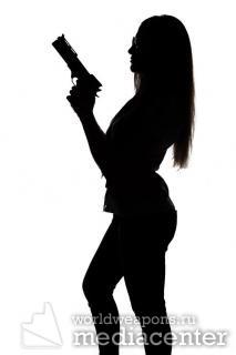 Sexy woman with gun. Девушка с оружием. Стоковое фото. Белый фон.